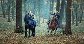 Viking Warrior Man In The Attack And Blond Viking Woman In Defence - Serious Viking Warriors Riding  poster