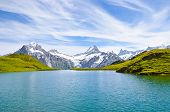 Beautiful Bachalpsee In The Swiss Alps Photographed With Famous Mountain Peaks Eiger, Jungfrau, And  poster