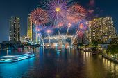 Fantastic Multicolor Firework Exploding Over The Bangkok Cityscape River Side For Celebration, Busin poster
