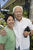 stock photo of early 60s  - Couple with Binoculars - JPG