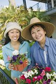 stock photo of early 60s  - Mother and Daughter Gardening Together - JPG