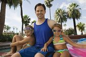 Man at Pool with Daughters