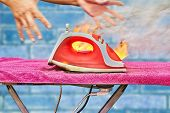 A Clothes Iron Is Connected To A Power Point Located On An Ironing Board, It Overheats And Ignites,  poster
