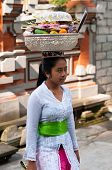 Balinese Woman Carrying Offerings On Her Head