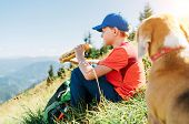 Little Smiling Boy Weared Baseball Cap Enjoying A Huge Baguette Sandwich And His Beagle Dog Friend W poster