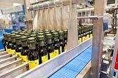 COLOGNE, GERMANY - MARCH 27 : New olive oil packing machine on display at Clevertech booth at the AN