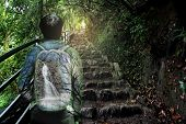 Overlay Waterfall And Forest On Bag Of  Backpack Behind Tourist Teen Boy With Steep Cobbled Pavement poster