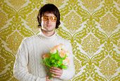 retro hip young man vintage glasses holding valentines flowers bouquet on wallpaper
