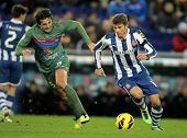 BARCELONA - FEB, 2: Samuele Longo(R) of RCD Espanyol fight with Hector Rodas of UD Levante during a