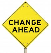 A yellow diamond-shaped road sign cautions people that change is ahead