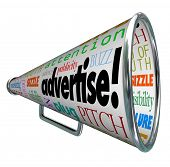 A bullhorn megaphone covered with words describing advertising such as advertise, promotion, public
