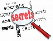 Secrets uncovered by a magnifying glass representing the search for clues in a mystery, with an inve