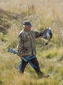 picture of pintail  - Man out waterfowl hunting in the fall - JPG