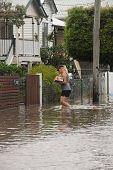 Brisbane, Australia - January 28 : Unidentified Resident Taking Groceries Through Flood Waters From