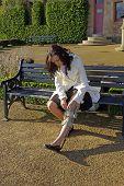 Girl Adjusting Leg Brace