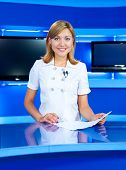 Television Newscaster At Tv Studio