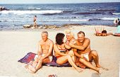 Vintage photo of happy family on beach (early seventies)