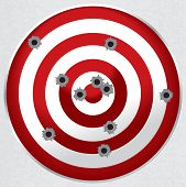image of bullet  - Red and white shooting range target shot full of bullet holes - JPG