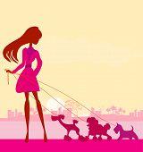 Pretty Girl Walking The Dogs