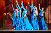 MOSCOW - JAN 28: Dancing collective in blue suits dances on stage of Red October Culture Palace duri