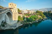 MOSTAR, BOSNIA - AUGUST 10, 2012: The Old bridge over the Neretva River on August 10, 2012 in Mostar, Bosnia. The old bridge is a reconstruction of a 16th century Ottoman bridge in the city of Mostar.