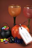 Happy Halloween Table Setting Decorations With Gothic Red And Orange Wine Goblet Glasses, Pumpkin An