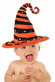 Adorable ten month old baby wearing a Halloween witch hat.