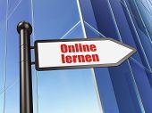 Education concept: Online Lernen(german) on Building background