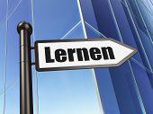 Education concept: Lernen(german) on Building background