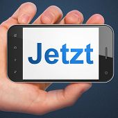 Time concept: Jetzt(german) on smartphone