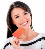 Happy woman holding a credit card - isolated over a white background