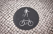 image of street-walker  - Bicycle and pedestrian lane road sign on the ground in Lisbon - JPG