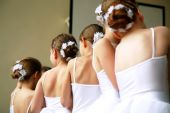 stock photo of ballet-dancer  - Little ballerinas dancing on a school show - JPG