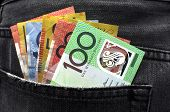 stock photo of twenty dollars  - Australian money including 100 50 5 10 and 20 dollar notes in back pocket of a man - JPG
