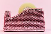 Pretty In Pink Bling Office Accessory Tape Dispenser Isolated Against A Pale Pink Background.