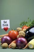 Eat Fresh Message Sign With Fresh Raw Vegetarain Food Including Eggplant, Onion, Corn, Tomatoes, Wal