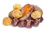 some panellets and roasted chestnuts and sweet potatoes, typical snack in All Saints Day in Cataloni