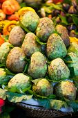 stock photo of sabbatical  - Cherimoya Fruit for sale at Barcelonas Saint Josep La Boqueria food markets - JPG