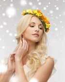 health and beauty, bridal concept - young woman wearing wreath of flowers