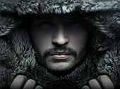 stock photo of hoods  - Portrait of a man wearing hood - JPG
