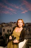 Young woman with binoculars