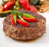 stock photo of hamburger-steak  - Tasty hamburger beef steak with grilled vegetable - JPG