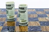 American Currency Stands On Marble Game Board