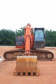 pic of heavy equipment operator  - Heavy Duty Construction Equipment Parked at Worksite - JPG