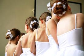 foto of ballet dancer  - Little ballerinas dancing on a school show - JPG