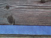 Wooden background with a checked ribbon