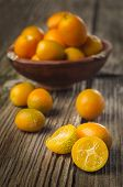 Tasty Kumquats On A Wooden Top