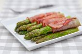 picture of white asparagus  - Bacon Wrapped Asparagus on a white plate - JPG