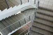 stock photo of bannister  - Stairs lead to the exit of the building - JPG
