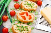 foto of scallion  - Delicious bruschetta with cherry tomatoes and scallion - JPG